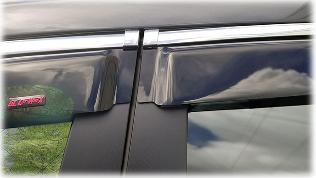 Shown is a close-up of the two-door abutment of the window visors on a 2020 model of Subaru Ascent: Set of four WV-19A-TF Tape-On Outside-Mount Window Visor Rain Guards With Chrome-Style Accent Trim to complement your model's OEM design and fit 2019, 2020, 2021 Subaru Ascent