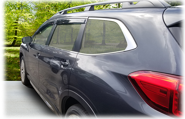 Shown on a 2020 model: Set of four WV-19A-TF Tape-On Outside-Mount Window Visor Rain Guards With Chrome-Style Accent Trim to complement your model's OEM design and fit 2019, 2020, 2021 Subaru Ascent