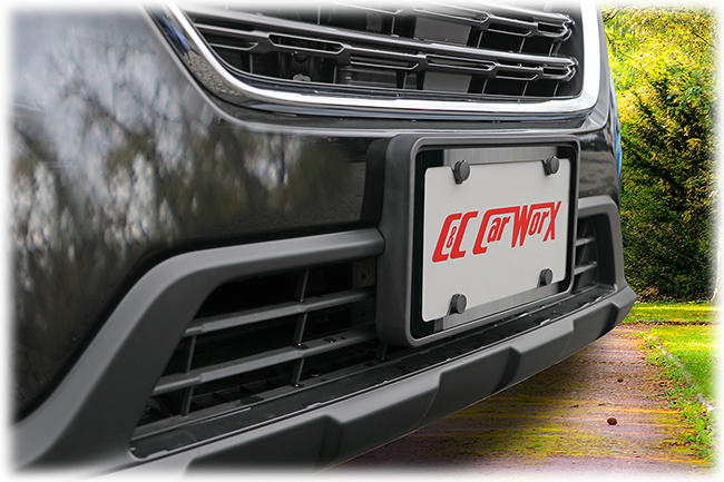 The C&C CarwWorx Front License Bracket and Black Stainless Steel License Plate Frame shown on a 2018 Subaru Outback gives a stylish flair to the vehicle's front end.