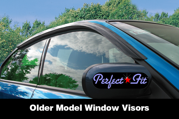 Shown is a 2-piece set of window visor rain guards on an older model Subaru Legacy Sedan